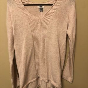 Light pink v-neck sweater.